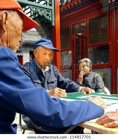 BEIJING, CHINA - OCT. 12, 2011 : unidentified eldery people playing a game of dominos on oct, 12, 2011 Beijing .By 2015 there will be 220 million people more than 60 years old in China