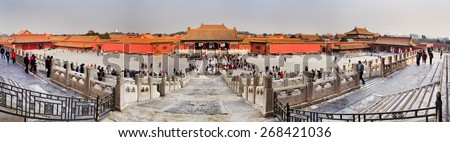 BEIJING, CHINA - OCT 28, 2014: Visitors at the The Forbidden City on October 2014 in Beijing,China.The Forbidden City is China\'s top tourist attraction, shot from within internal square with palaces.