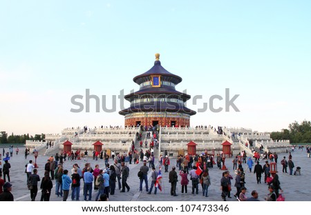 BEIJING, CHINA - OCTOBER 14: People visit the famous Temple of Heaven on October 14, 2011 in Beijing, China. The Temple of Heaven was selected as a UNESCO World Heritage Site in 1998 - stock photo