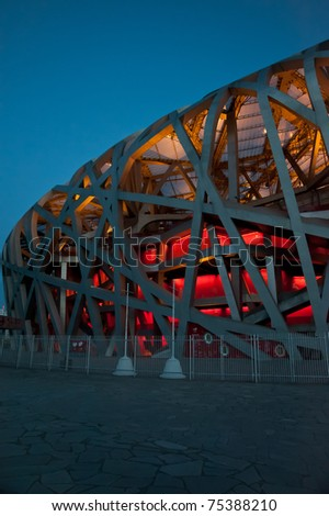 "BEIJING-CIRCA APRIL 2011:Dusk falls at the National Stadium in Beijing circa April 2011. Also known as the ""Bird's Nest"", it draws 20,000 to 30,000 visitors a day, despite lack of significant events."