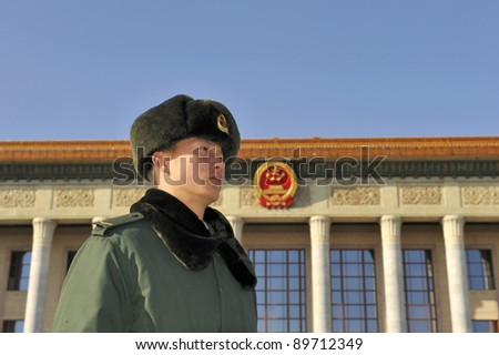 BEIJING - DEC 14: A sentry stands guard in front of The Great Hall of the People in Beijing, China on Dec 14, 2010.