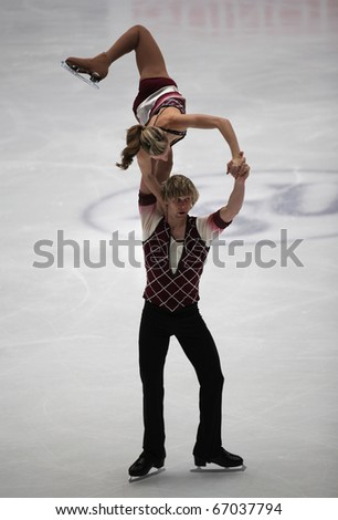 BEIJING-DEC 11: Ashley Cain and Joshua Reagan of USA perform in the Junior Pairs-Free Skating event of the ISU Grand Prix of Figure Skating Final on Dec 11, 2010 in Beijing, China.