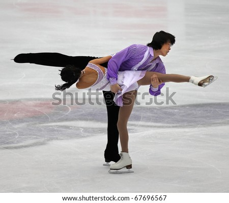 BEIJING-DEC 11: Qing Pang and Jian Tong of China perform in the Pairs-Free Skating event of the ISU Grand Prix of Figure Skating Final on Dec 11, 2010 in Beijing, China.