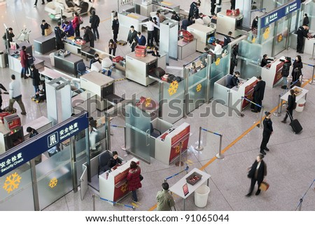 BEIJING - DEC. 16. Security check area at Beijing Capital Airport. The airport registered 488,495 aircraft movements (take-offs + landings), ranked 10th in the world. Beijing, Dec. 16, 2011. - stock photo
