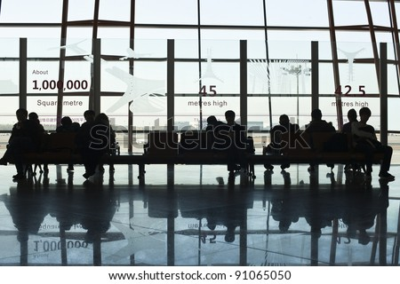 BEIJING - DEC. 16. Travelers in the departure hall, Beijing Capital Airport on Dec. 16, 2011. The airport registered 488,495 aircraft movements (take-offs + landings), ranked 10th in the world.