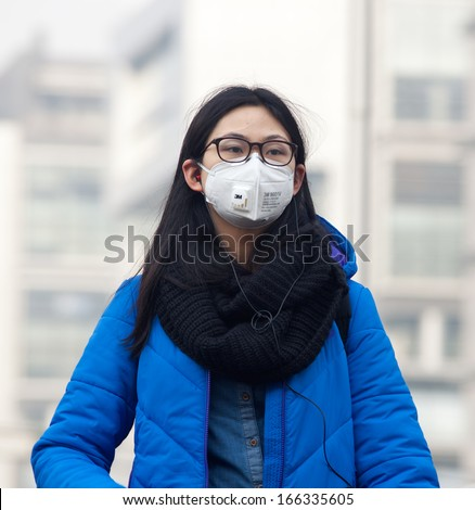 Beijing-Dec 8: Woman With Face Mask Is Seen On Dec 8, 2013 In Beijing, China. 104 Cities In China Suffered From Severe Air Pollution On Dec 7, With Beijing Among That Hit The Hardest