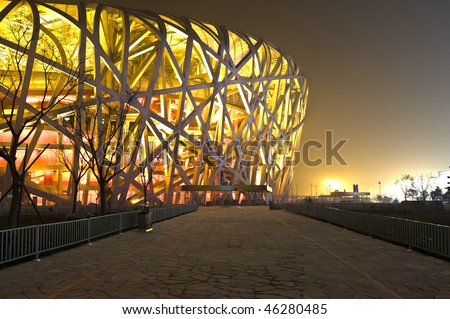 stock-photo-beijing-december-the-bird-s-nest-located-in-gym-plaza-lights-up-for-celebrating-the-nearby-46280485.jpg