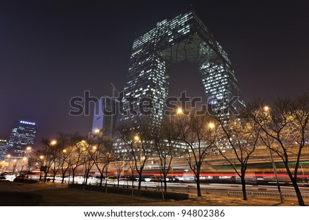 BEIJING - FEB. 03: CCTV Headquarters and intersection at night on Feb. 03, 2012 in Beijing, China. CCTV building is a loop of six horizontal and vertical sections which total floor space is 473,000 square meters.