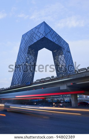 BEIJING - FEB. 03: CCTV Headquarters with light trials on Feb. 03, 2012 in Beijing, China. The CCTV building is a loop of six horizontal and vertical sections with a total floor space of 473,000 square meters.