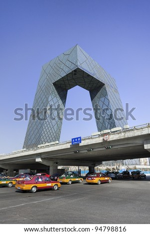 BEIJING - FEB. 08: CCTV Headquarters with taxis on Feb. 08, 2012 in Beijing, China. The building is a 234 m, 44-floor skyscraper in downtown Beijing and headquarters for China Central Television (CCTV).