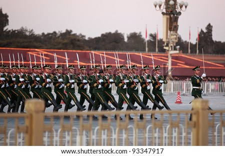 BEIJING-FEB 01: Chinese military march with rhythm and synchronization to lower the National flag on Tiananmen Square on Feb 1,2011 in Beijing,China.The ceremony is held everyday at sunset