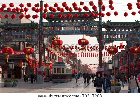 BEIJING-FEB 2: Qianmen street is decorated with Chinese New Year ornaments on Feb 2, 2011 in Beijing, China, ahead of the Chinese New Year, the year of the rabbit, which starts on Feb 3 this year