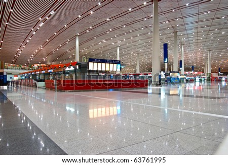 Beijing internationl airport interior at night.