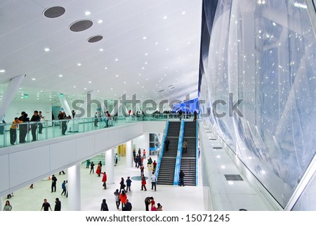 BEIJING - JULY 2008: People walk inside the National Aquatics Center in Beijing. The center, also known as the Water Cube, was built for the upcoming Beijing 2008 Olympic Games.