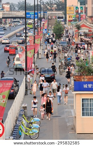 BEIJING-JULY 10, 2015. Street with advert banners. China\'s outdoor advertising market grows annually more than 23% since 2000, versus 17% for the overall ad market, 14% for TV and 16% for newspapers.