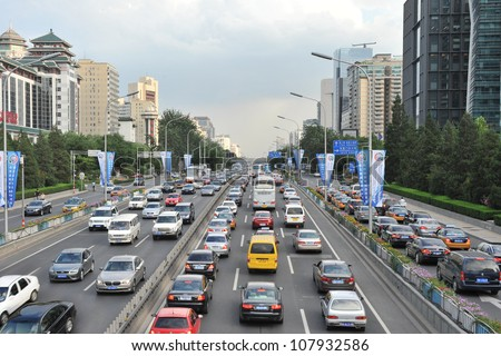BEIJING - JULY 12: Traffic jam in Beijing's Central Business District on July 12, 2012 in Beijing, China. Beijing is expected to pass the six million vehicles on its roads by the end of the year.