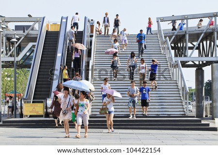 BEIJING JUNE 5, 2012. Pedestrian bridge in Beijing Xidan shopping area on June 5, 2012. Because of the congested traffic, with 5 million cars at the end of 2012, Beijing has many pedestrian flyovers. - stock photo