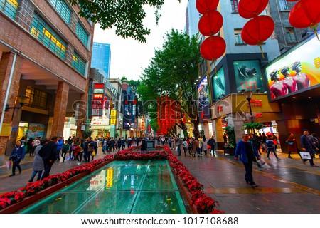 BEIJING LU, GUANGZHOU SHI, GUANGDONG, CHINA - JAN 2018: Busy Beijing Road street scene with a canopy of red lanterns and people shopping - Beijing Lu main shopping street, Guangzhou, China.