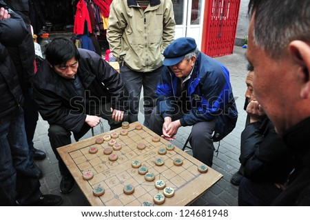 BEIJING - MAR 14:Chinese people play Xiangqi (Chinese Chess) in Beijing,China on March 14 2009.It's one of the most popular board game in the world, played by millions of people in China and Asia.