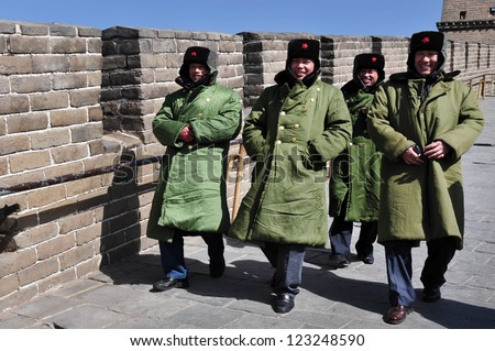 BEIJING - MAR 10:Chinese soldiers on the Great Wall of China on March 10 2008.The PLA is the worlds largest military force and the worlds active standing army, with approximately 2.25 million members.