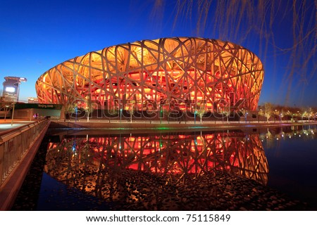 BEIJING - MARCH 26: Beijing National Stadium, also known as the Bird's Nest, at dusk on March 26, 2011 in Beijing, China. The 2015 World Championships in Athletics will take place at this famous venue