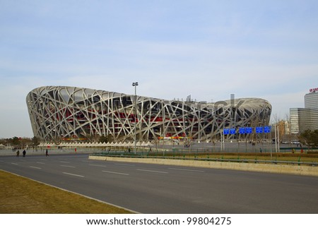 BEIJING - MARCH 22. Bird's nest stadium at day time on March 22, 2012. The Bird's Nest is a stadium in Beijing, China. It was designed for use throughout the 2008 Summer Olympics and Paralympics.