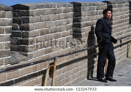 BEIJING - MARCH 10:Chines man on the Great Wall of China on March 10 2008. The Great Wall of China is the longest man-made structure in the world.