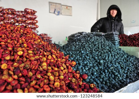 BEIJING - MARCH 10:Chinese man sells dry fruits on March 10 2008 in Beijing, China.Dried fruits retain most of the nutritional value of fresh fruits and help reduce the risk of chronic disease.