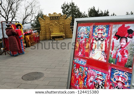 BEIJING - MARCH 11:Chinese women wearing costumes at Jingshan Park on March 11 2009 Beijing, China.It's a 45.7m high artificial hill that constructed by Ming Dynasty of an area of more than 230,000 m²