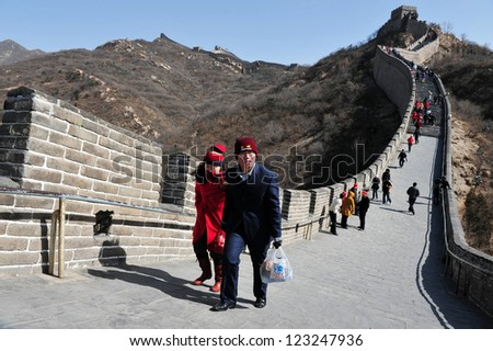 BEIJING - MARCH 10:Visitors walks on the Great Wall of China on March 10 2008. Four million people visits the great wall each year.