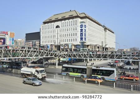 BEIJING - MARCH 12, 2012. Xidan shopping street Beijing on March 12, 2012. The 3,4 miles long Xidan shopping street is very popular among Beijingers, offering many shops, malls and entertainment.