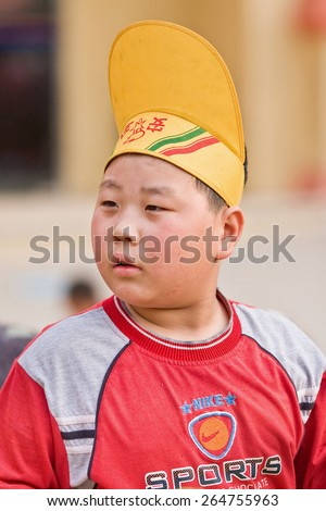 BEIJING-MAY 21, 2008. Over weighted boy with funny hat. China\'s child obesity is alarming: According a recent study, 23% of Chinese boys under age 20 are overweight, comparable figure for girls is 14%