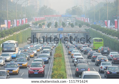 BEIJING - MAY 9: Traffic jam and smog in Beijing's Central Business District on May 9, 2012 in Beijing, China.Beijing is expected to pass the six million vehicles on its roads by the end of the year.