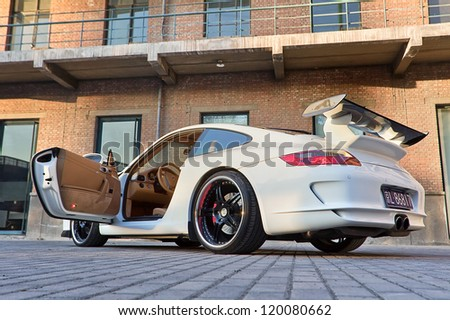 BEIJING-NOV. 8: Parked customized Porsche. Porsche may deliver more cars in China than in its German home market by 2011, according the Jebsen Group, Porsche dealer on Nov. 8, 2010 in Beijing.