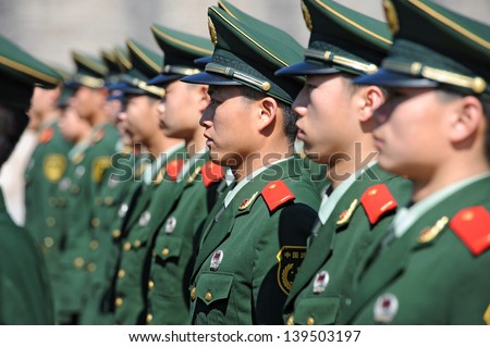 BEIJING - NOV 8: Soldiers stand guard in Tiananmen area during China's 18th National Congress on November 8, 2012 in Beijing, China.Security is extra tight because of leadership transition.