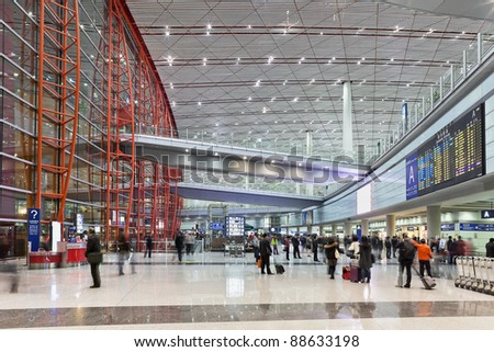 BEIJING - NOV. 10: Travelers pass through the arrival hall in Beijing Capital Airport Terminal 3 on Nov. 10, 2011 in Beijing, China. The airport registered 488,495 aircraft movements (take-offs and landings), ranked 10th in the world.