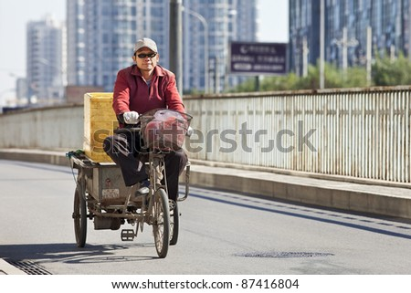 BEIJING - OCT. 25: Cargo bike on the road in Beijing, Oct. 25, 2011. Although their number is declining, cargo bikes or freight tricycles are still a popular transportation mode in China.