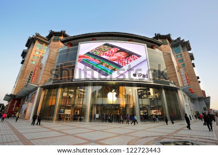 BEIJING - OCT 22: people walking in front of Apple store on Wangfujing street on October 22, 2012 in Beijing, China. This store just opened and is Asia's biggest Apple store with 2,300 square meters.