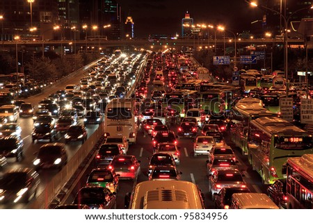 BEIJING-OCT 25: Traffic jam in Beijing's Central Business District at night on Oct 25, 2010 in Beijing, China. Beijing is expected to pass the five million vehicles on its roads by the end of the year