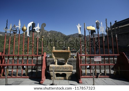 BEIJING - OCTOBER 13: Ancient weapons on display at the Great Wall of China on October 13, 2012 in Beijing, China.The wall protects Beijing was refortified in the 16th century in the Ming Dynasty. - stock photo