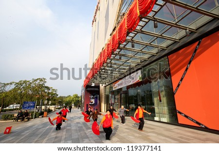 BEIJING - OCTOBER 14: Elderly women practice fan dance outside a shopping mall on October 14, 2012 in Beijing, China. Healthy living is promoted here as medical and healthcare cost escalates.