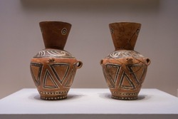 BEIJING - October 12 : Painted Pottery Jars with Handles October 12, 2019 in Beijing, China. Ancient Chinese Dawenkou Culture(c 4200-2500 BC).