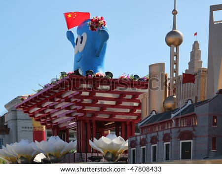 BEIJING - OCTOBER 3: Shanghai World Expo 2010 mascot Haibao and replicas of Shanghai landmarks are on display during China's 60th anniversary at Tiananmen Square on October 3, 2009, in Beijing, China.