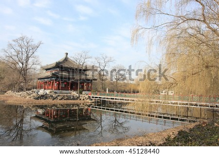 Beijing: old summer palace, pavilion and reflection on the lake in winter