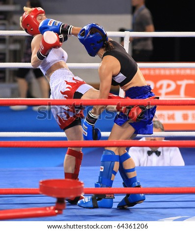 BEIJING-SEP 04: Eva Liskova of Czech Republic(R) fights against Doris Kohler of Austria during the Kickboxing competitions of the SportAccord Combat Games 2010 Beijing on Sep 04, 2010 in Beijing,China