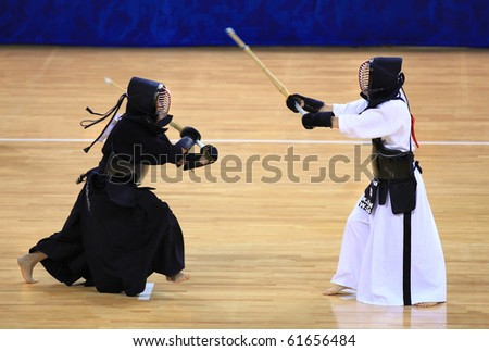 BEIJING-SEP03: K.A. Sylvester of Australia(L) fights against K.H.Jeon of Republic of Korea(R) during the Kendo competitions of the SportAccord Combat Games 2010 Beijing on Sep 03,2010 in Beijing,China