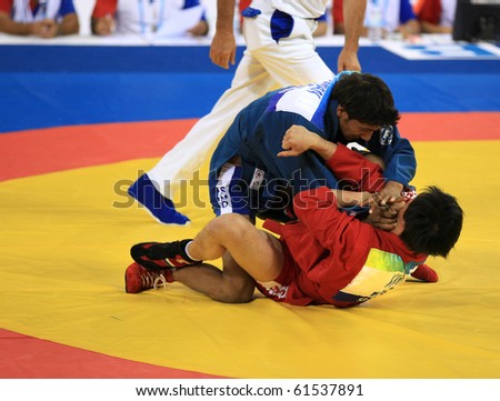 BEIJING-SEP 03: Kwangsub Kim of Republic of Korea(B) fights against Amandeep Mr of India(T) during the Sambo competitions of the SportAccord Combat Games 2010 Beijing on Sep 03, 2010 in Beijing, China