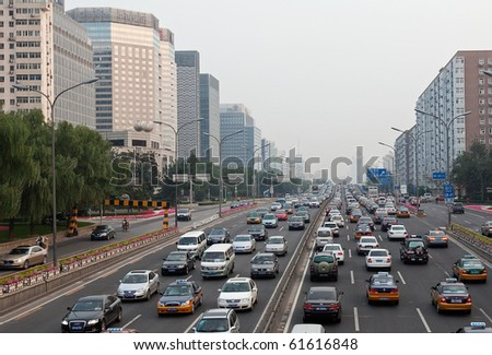 BEIJING-SEPTEMBER 24: Traffic jam on ring road during rush hour on Sep 24, 2010 in Beijing, China. Beijing is expected to pass the five million vehicles on its roads by the end of the year.