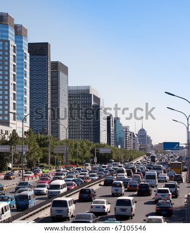 Beijing skyline and traffic jam on ring road. China