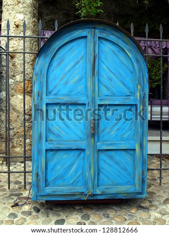 Being a blue door cabinet with silver souvenir trade place on the streets of the old town of Mostar in Bosnia and Herzegovina